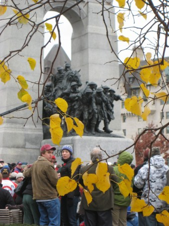 Crowds gather beside Ottawa's War memorial statue on Remembrance Day 2008. (photo: Lucy Martin)