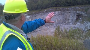 A NYCO official points at forest preserve land that will be mined under a land swap on 2013 ballot (Photo:  Brian Mann)