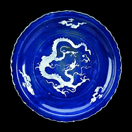 Yuan or early Ming Dynasty Dragon Charger, reverse white slip on blue ground, 16 in (40.5 cm) diameter. Image courtesy of Walker's Fine Art & Estate Auctions