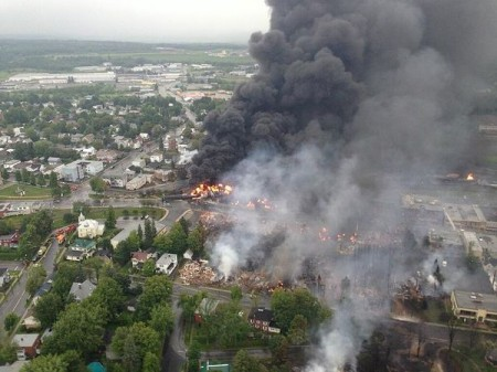 Lac-Megantic burning on the first day after the rail car derailment sent fireballs and streams of burning oil coursing through the Quebec village. Photo: Surete du Quebec