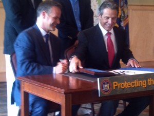 Gov. Andrew Cuomo signing the original Finch, Pruyn purchase in 2012. Photo: Brian Mann