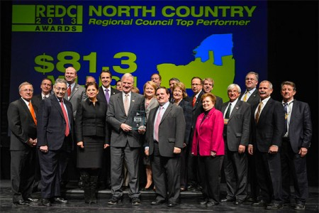 Clarkson University President Tony Collins (center) holds a top performer award given to the North COuntry Regional Economic Deleopment COuncil in today's awards announcement. Photo: Office of Gov. Cuomo