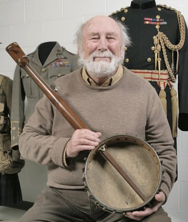 Donor Alec Somerville holding the banjo signed by 28 members of the Canadian Expeditionary Force during World War 1. Photo courtesy of the Canadian War Museum