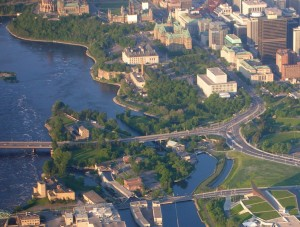 Victoria island (bottom) in the Ottawa River, connected by bridge to City of Ottawa near Parliament hill (top). Wikipedia image by Shanta Rohse