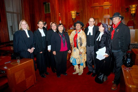 Chief Roger William (the representive plaintiff, centre), standing next to Chief Judy Wilson (Secwepemc) and Chief Wayne Christian (Secwepemc) and the Tsilhqot'in Legal team (David Rosenberg, Jay Nelson) and the Secwepemc, Okanagan, UBCIC legal team (Louise Mandell, Ardith Walkem and Prof. Nicole Schabus - far left in the picture. Photo: Thompson Rivers University, Creative Commons, some rights reserved