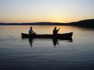 Canoeing Algonquin Park two people sunset lake Canada Ontario. Photo: Acqumen Enterprises, Creative Commons.