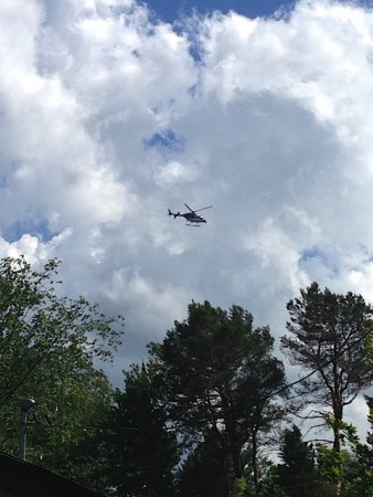 A helicopter sweeps overhead, keeping watch over roads and trails.  Photo:  Julia Ferguson